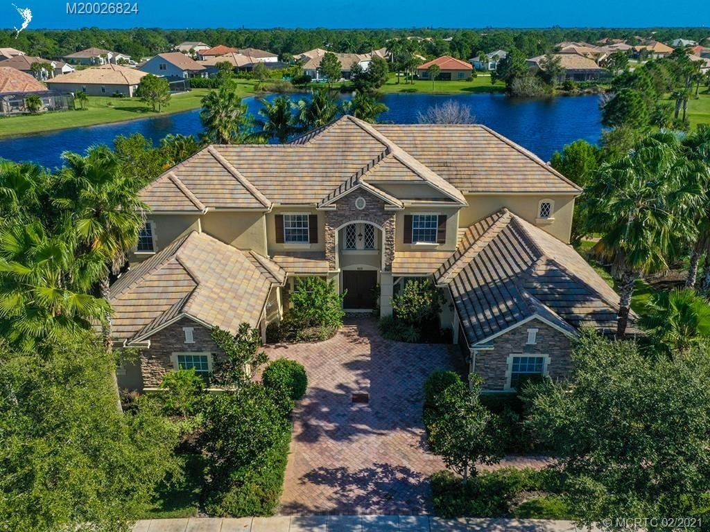 15. Single Family Homes for Sale at Palm City, FL 34990