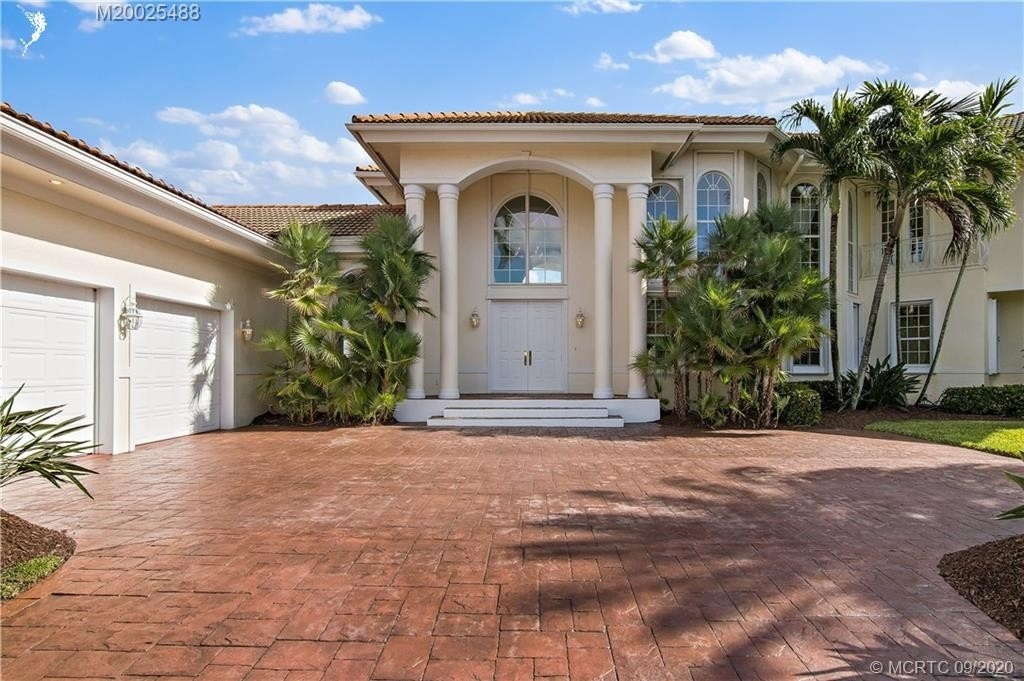 29. Single Family Homes for Sale at Palm City, FL 34990