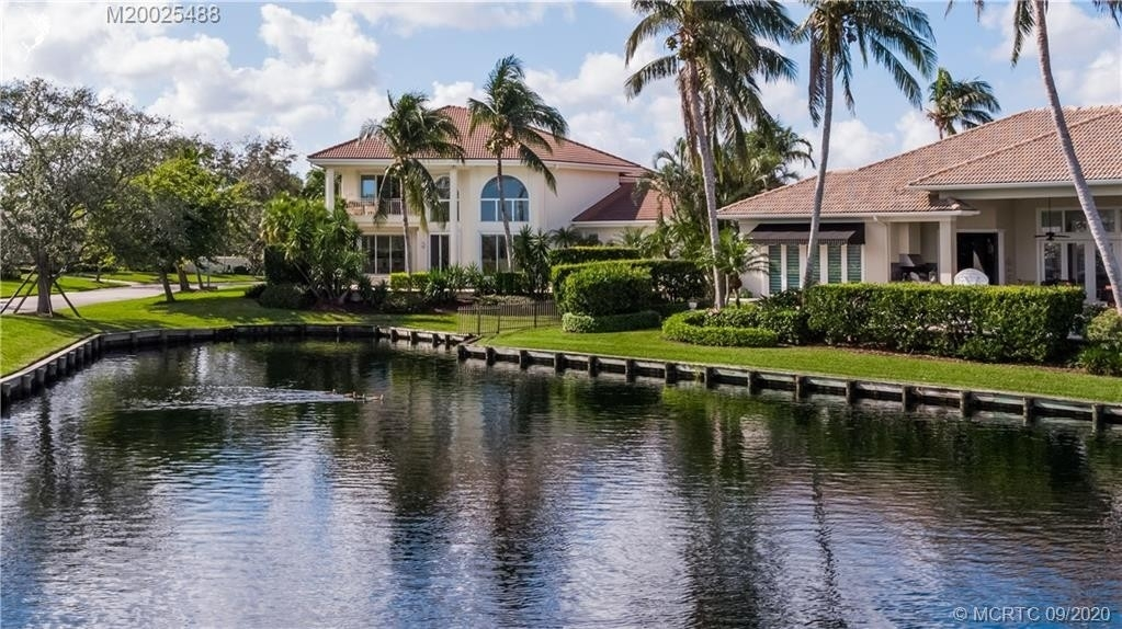 31. Single Family Homes for Sale at Palm City, FL 34990