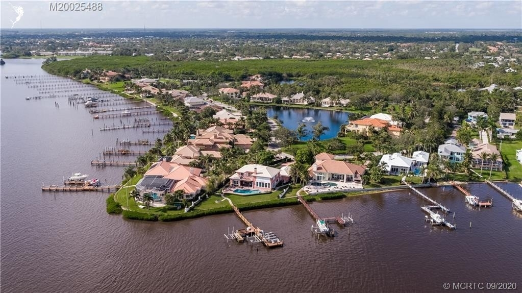 34. Single Family Homes for Sale at Palm City, FL 34990