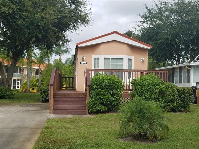 21. Single Family Homes pour l Vente à Caliente Casita Village, Land O' Lakes, FL 34637