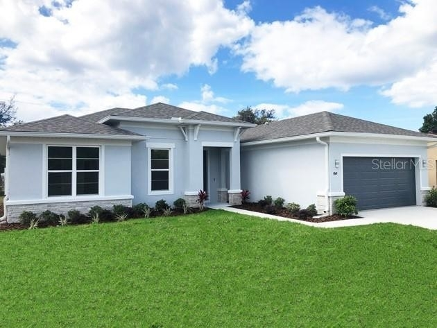Single Family Home at Lehigh Woods, Palm Coast, FL 32164