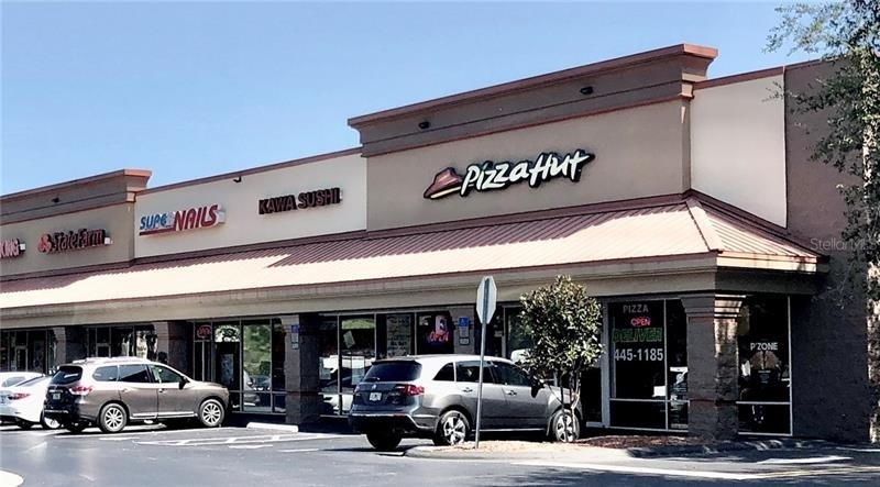 Retail Leases pour l Vente à 1475 PALM COAST PARKWAY NW, 105 Downtown Palm Coast, Palm Coast, FL 32137