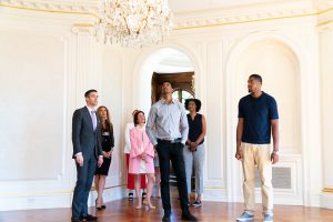 NBA stars Malcolm Miller (center) and Derrick Favors (right) tour 18 Frick Drive with Noble Black.