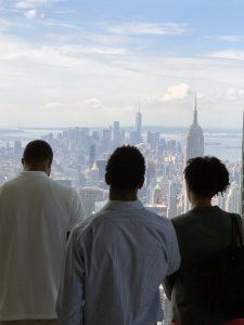 Favors, Miller and Lovelace overlooking Manhattan from 432 Park Avenue.